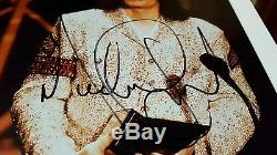 Michael Jackson autographed photo. Authentic Real signature not a copy! Signed