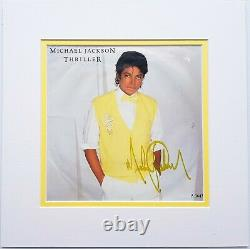 Michael Jackson signed UK Thriller EP single 7 autographed MJ double matted